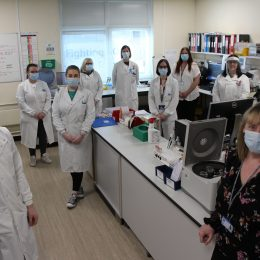 Biomedical scientists involved in a special plasma study for COVID-19.