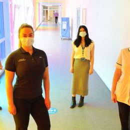 Therapy team stood in corridor at North Tees hospital.