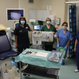 Gynaecology team stood in clinic room
