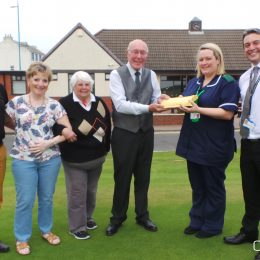 Seaton Carew Golf Club fundraisers Peter Hamilton, Jackie Hamilton, Yvonne Fisher and Ian Phillips with Clinical Nurse Specialist Helen Dicken from the North Tees and Hartlepool NHS Foundation Trust Specialist Palliative Care Team and Business Lead for the North Tees and Hartlepool NHS Foundation Trust Richard Scott.